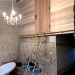 Bardage intérieur en peuplier avec échelle laiton